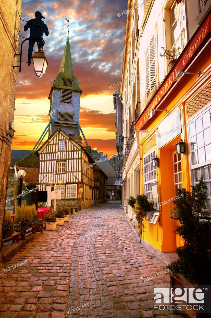 Stock Photo: street at sunset with church and half timbered building  Honfleur, Normandy, France.