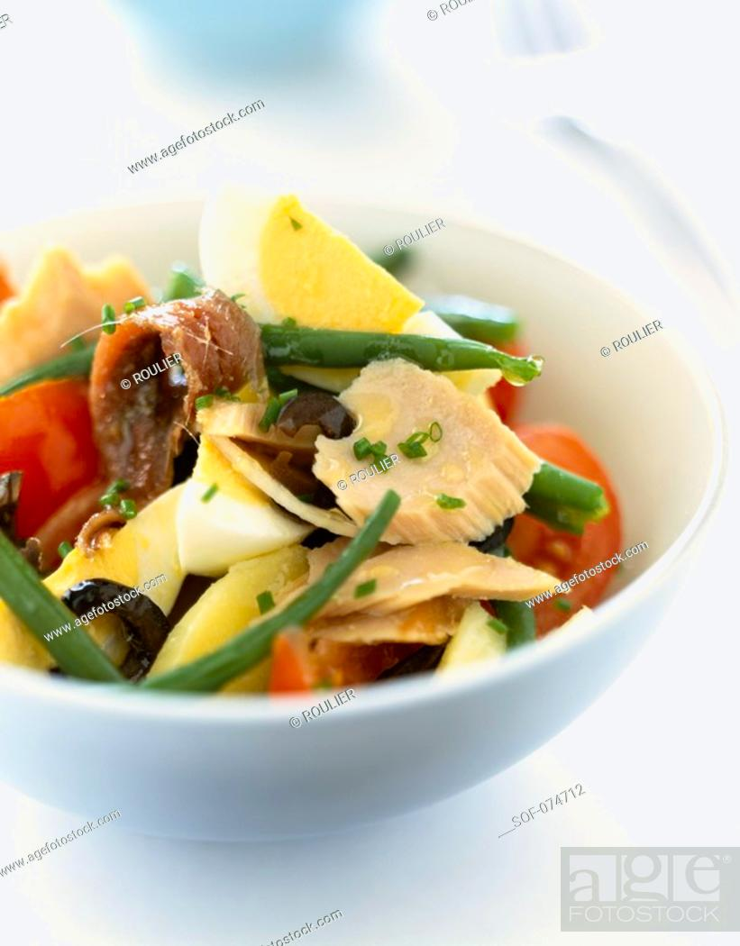 Stock Photo: Mixed salad with tuna and anchovies.