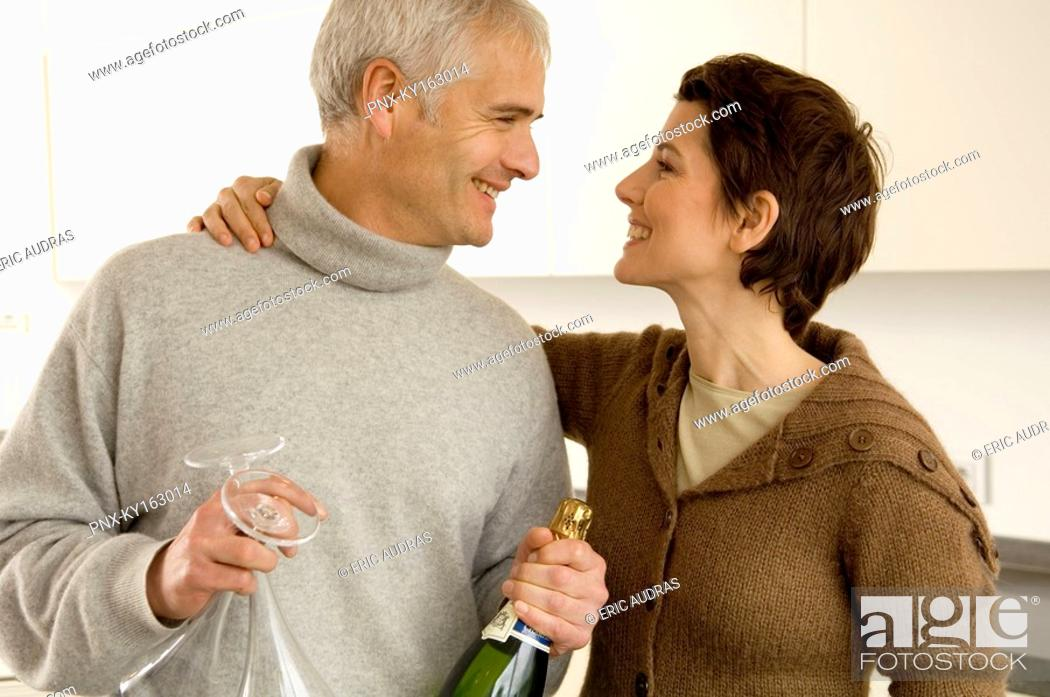Stock Photo: Mature man and a mid adult woman looking at each other.