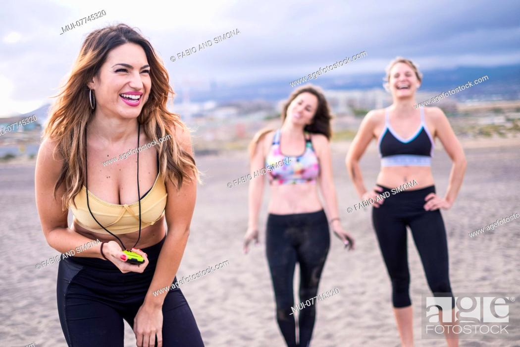 Stock Photo: group of fitness young woman 25 years old resting and have fun together in friendship. class of workout fitness concept in outdoor leisure sport activity.