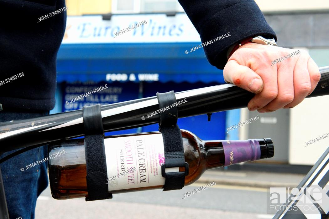 """Stock Photo: A wacky inventor has launched a product for carrying bottles of booze to your Christmas party. Called the """"""""thingumy"""""""", the £6 universal bicycle mount can."""