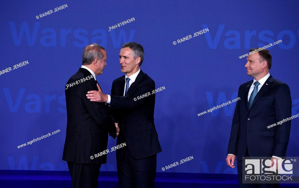 Stock Photo: Turkish President Recep Tayyip Erdogan (l) being welcomed by Nato General Secretary Jens Stoltenberg (c)and Polish President Andrzej Duda at the national.