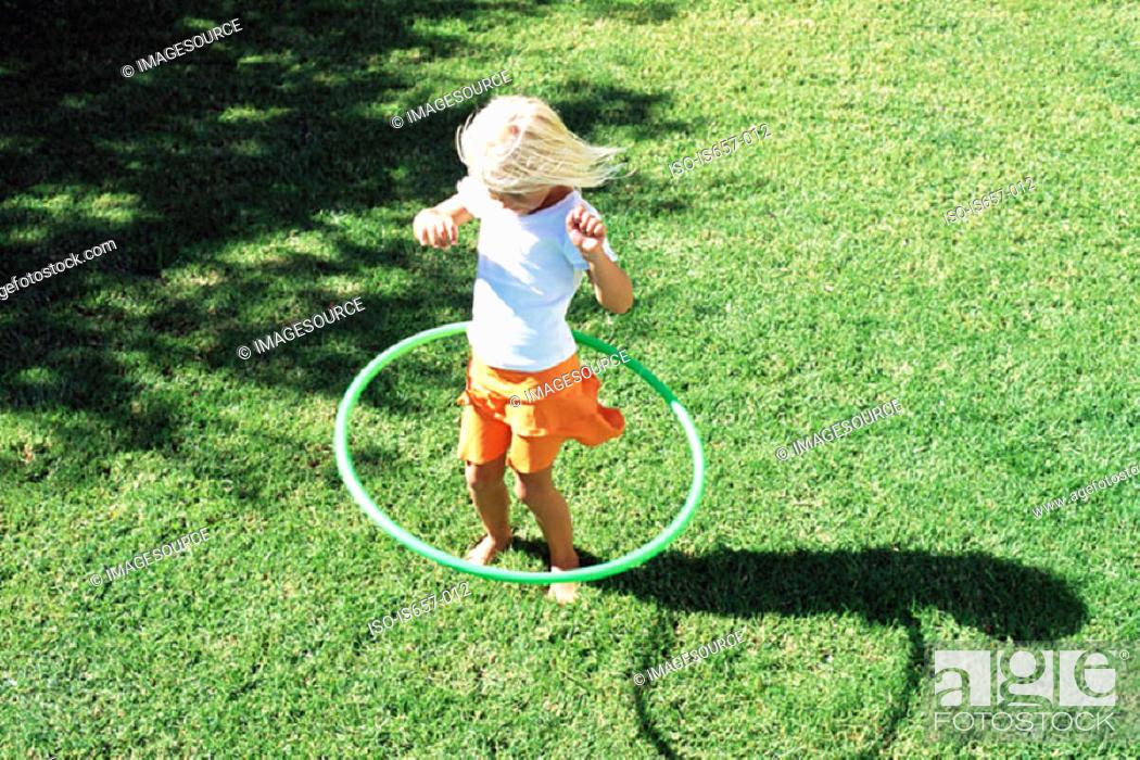 Stock Photo: Girl playing with hula hoop.