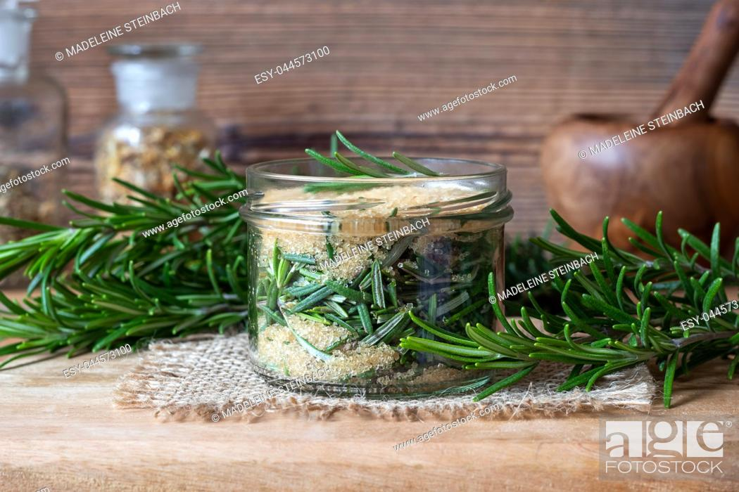 Stock Photo: Preparation of a homemade rosemary syrup from fresh plant and cane sugar.