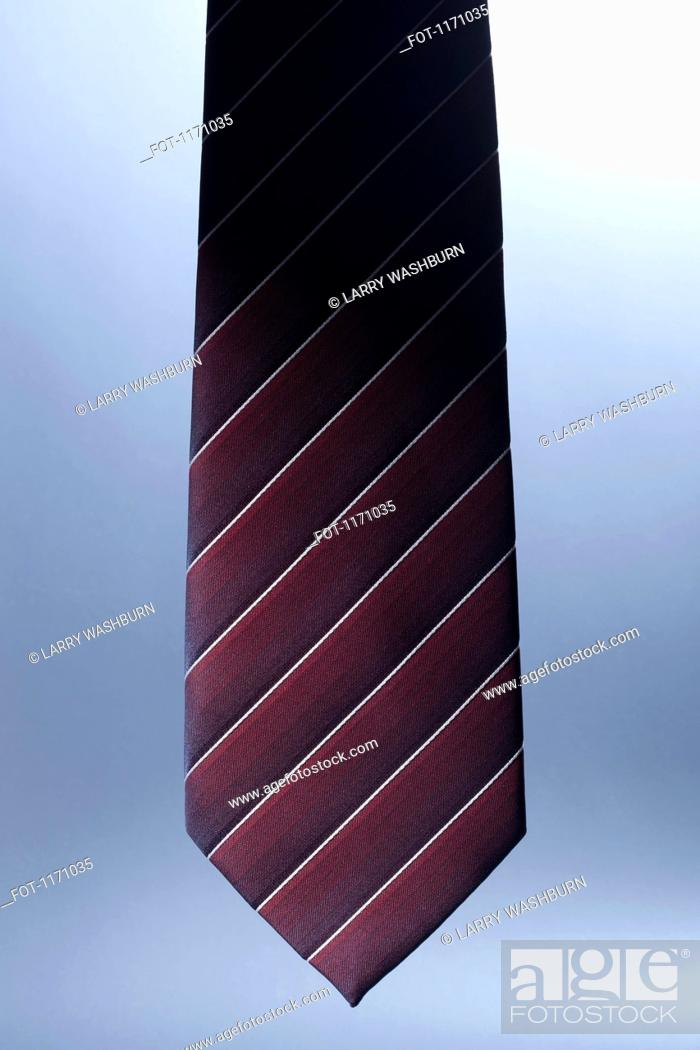 Stock Photo: The bottom of a striped, silk necktie.