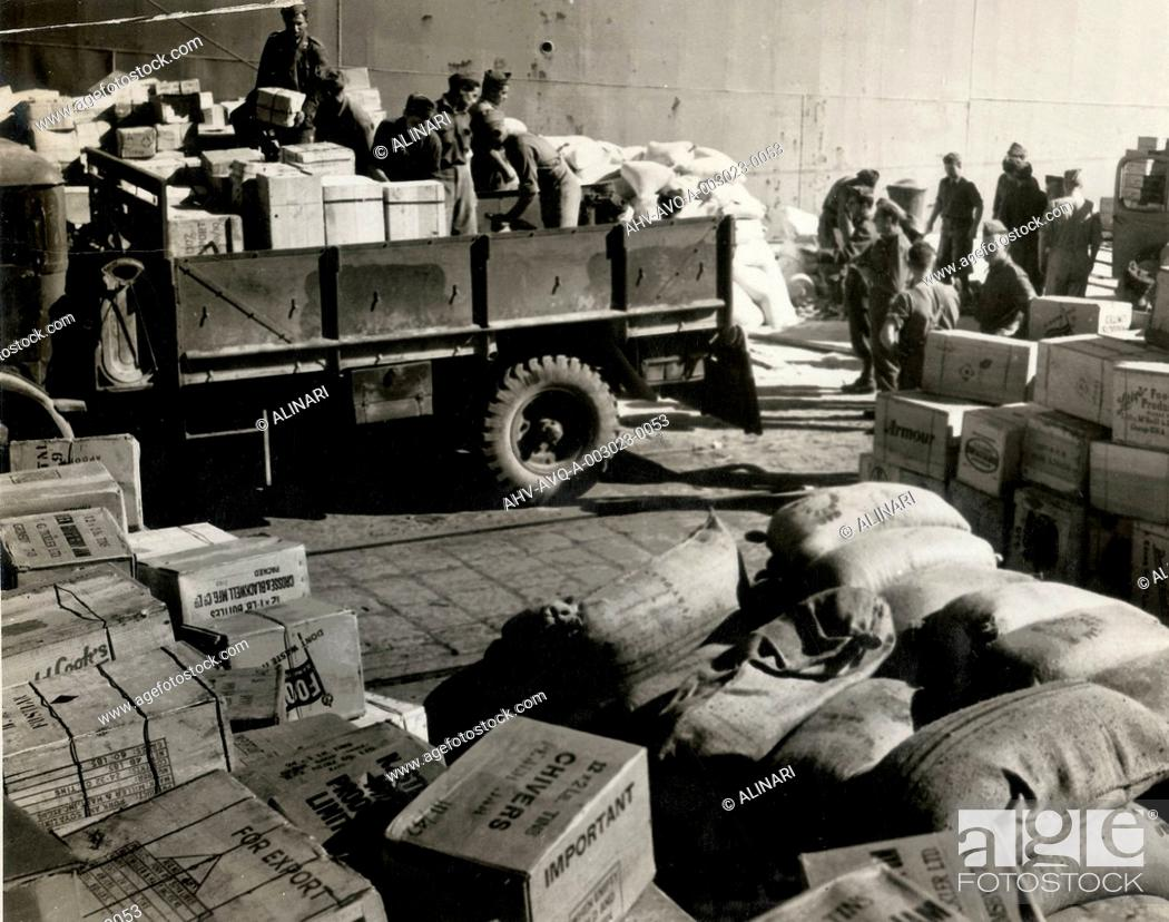 Stock Photo: Foodstuffs & Munitions being unloaded in Naples Port from italian troops, Naples, shot 1944.