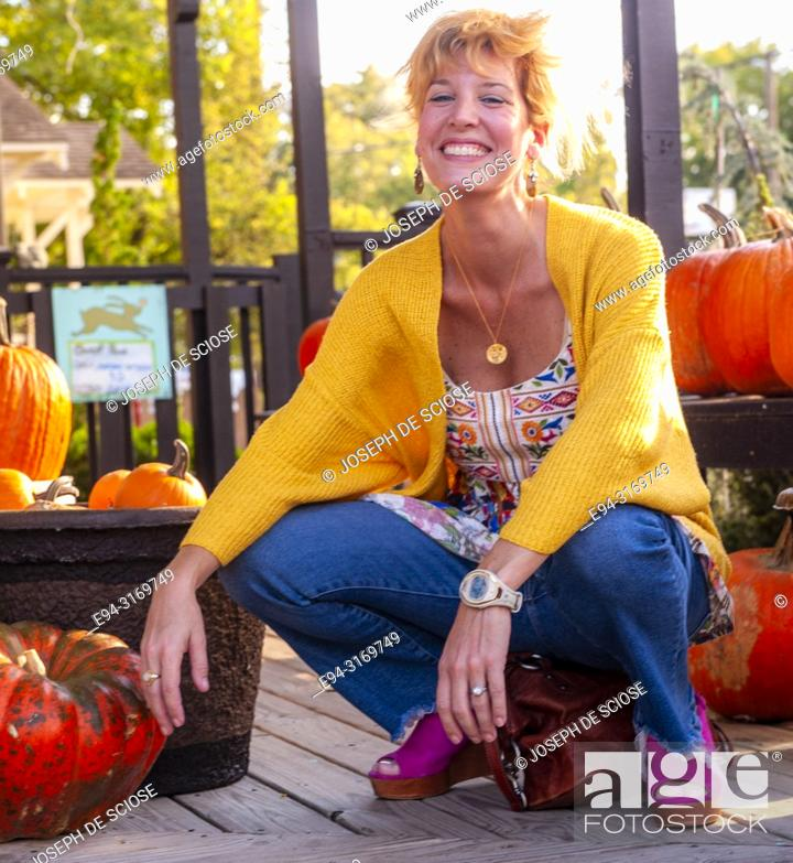 Stock Photo: A pretty 42 year old blond woman shopping at a garden store.
