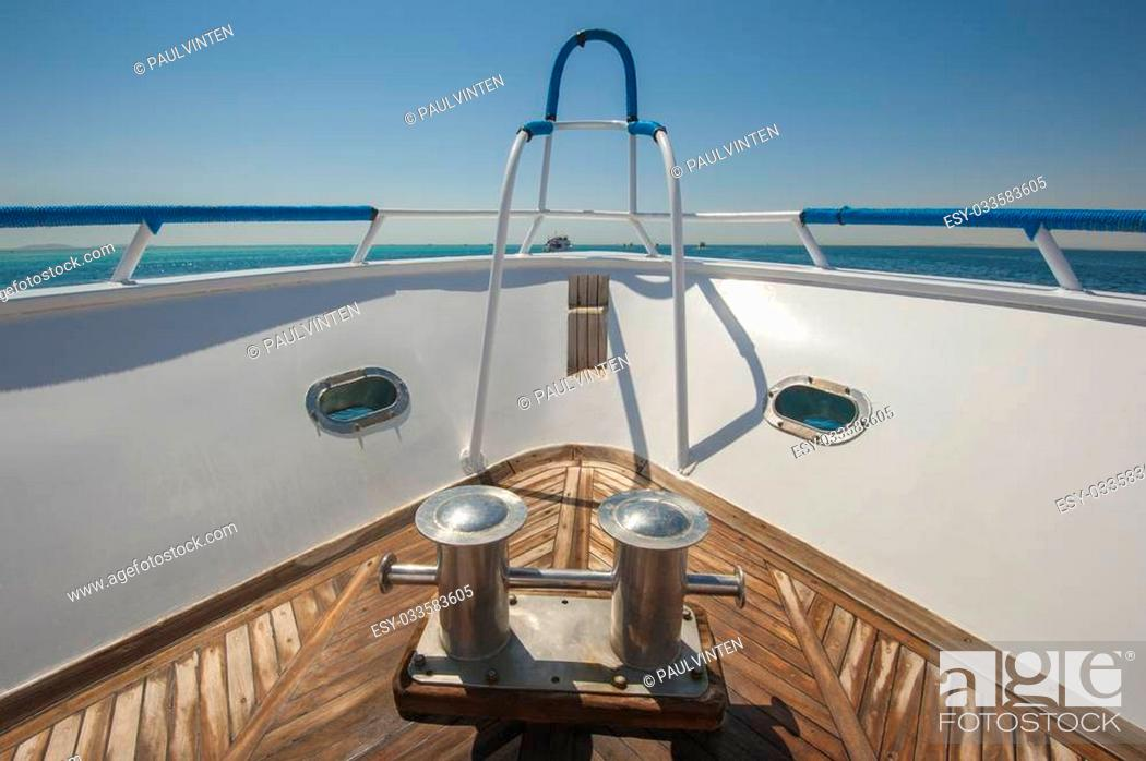 Stock Photo: View from the bow of a luxury motor yacht on a tropical ocean.