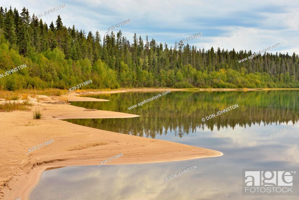Stock Photo: Reflections in Pine Lake, Wood Buffalo National Park, Alberta, Canada.