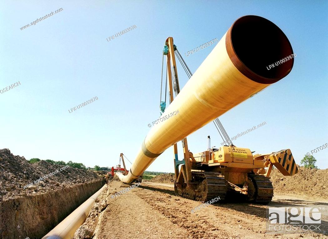 Stock Photo: Positioning flexible steel pipes using crane.