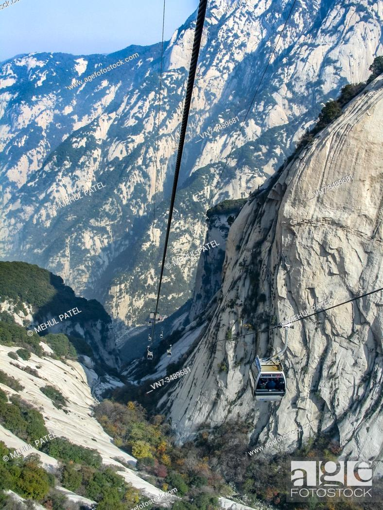 Stock Photo: Cable Cars taking visitors to and from the summit of the sacred Mount Huashan, China, Asia. Mount Huashan is located in the Shaanxi province of China about.