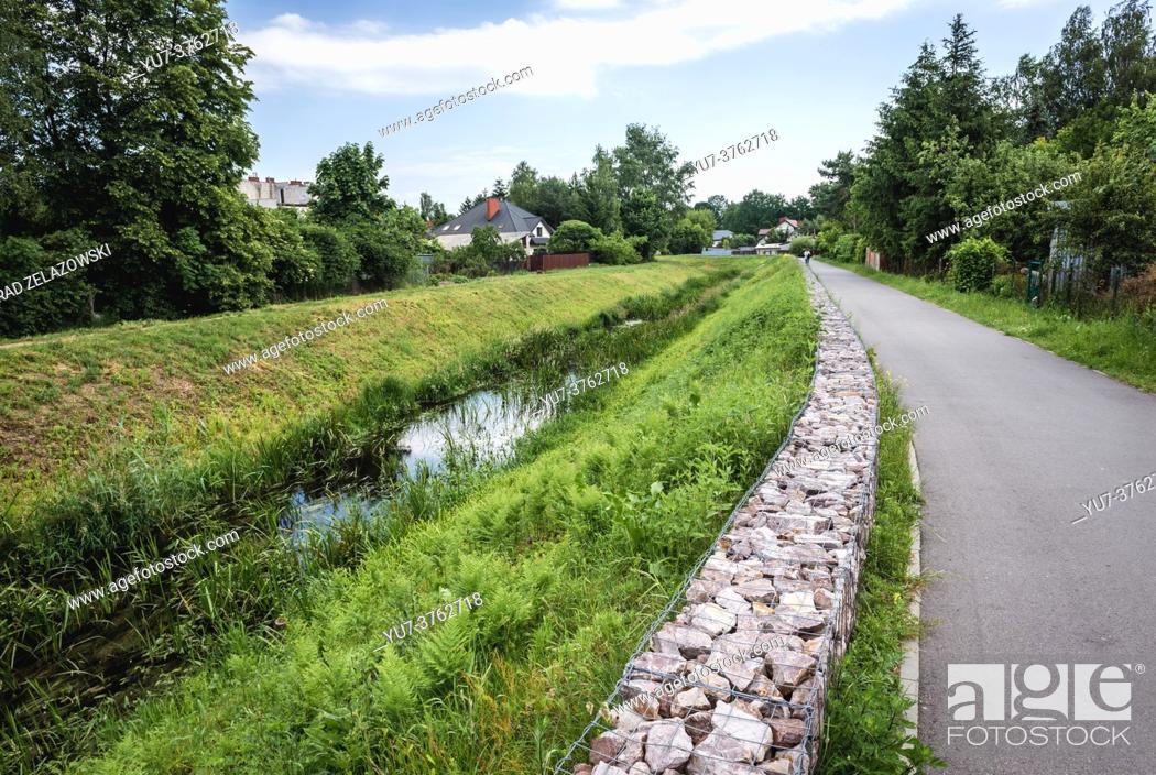 Stock Photo: Dluga River - Long River - in Zielonka town in Wolomin County, Masovian Voivodeship, Poland.