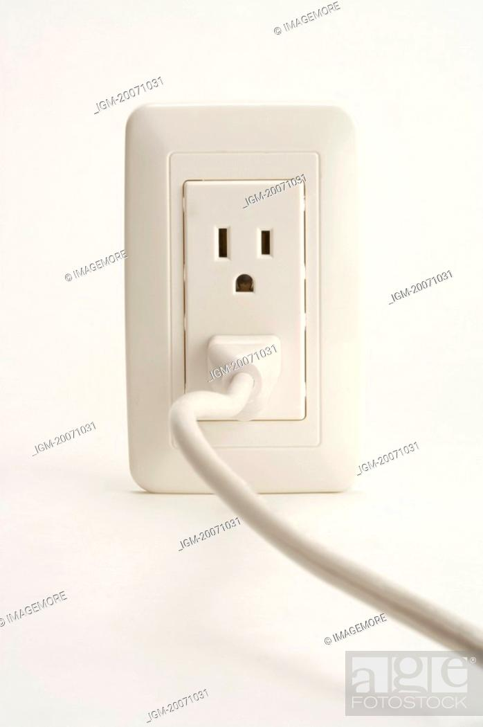 Stock Photo: Electric Plug and Outlet.