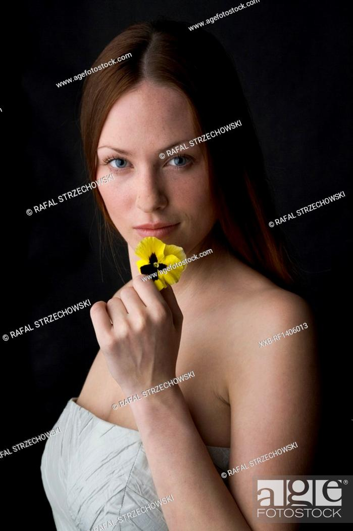 Stock Photo: young wman smelling the flower.