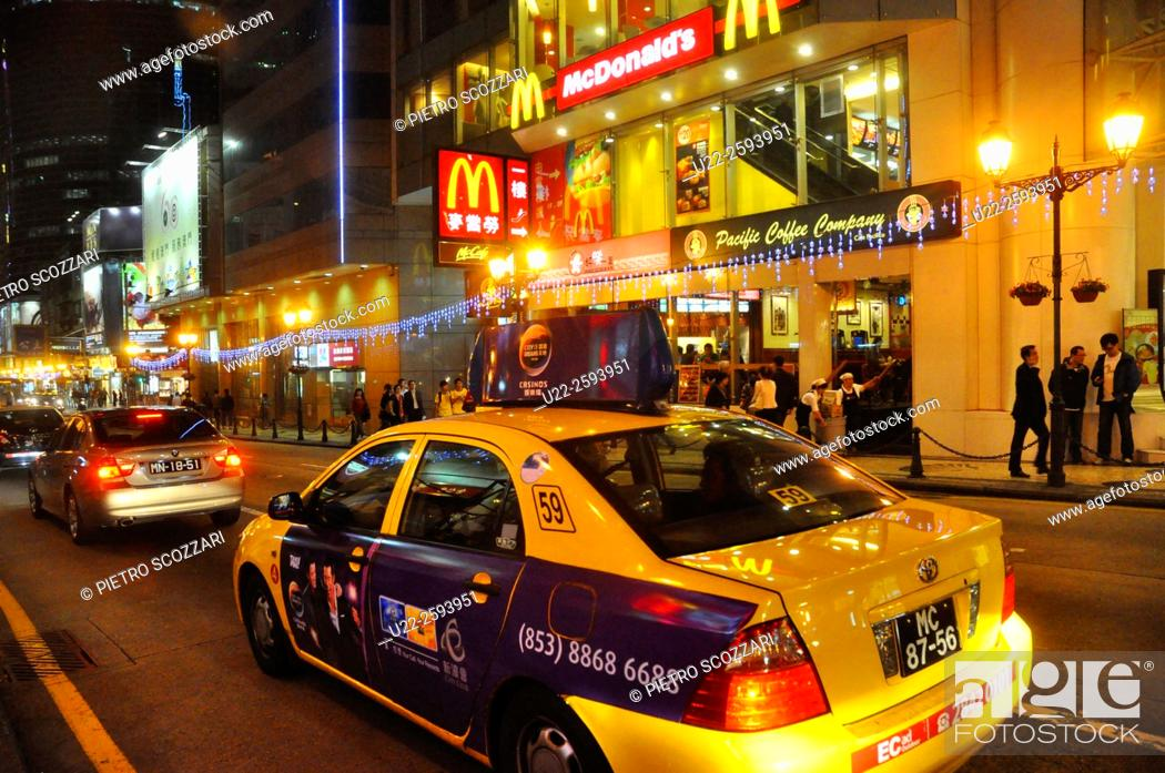 Stock Photo: Asia, China, Macao, taxis and Mc Donald's in the city center at night.