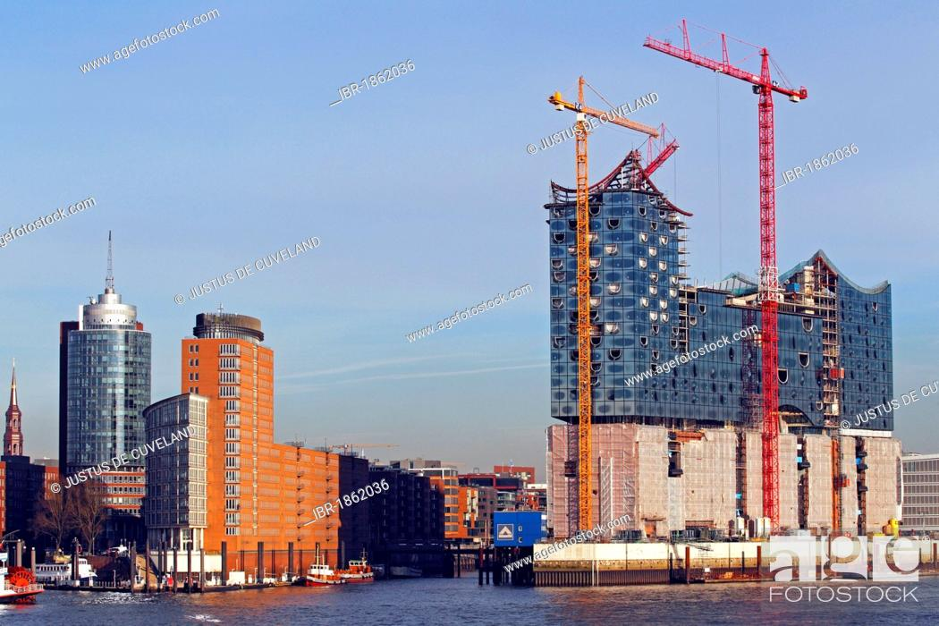 Stock Photo: Elbe Philharmonic Hall building site, right, in HafenCity, and the HTC Hanseatic Trade Center at the Kehrwiederspitze, Port of Hamburg on the Elbe River.