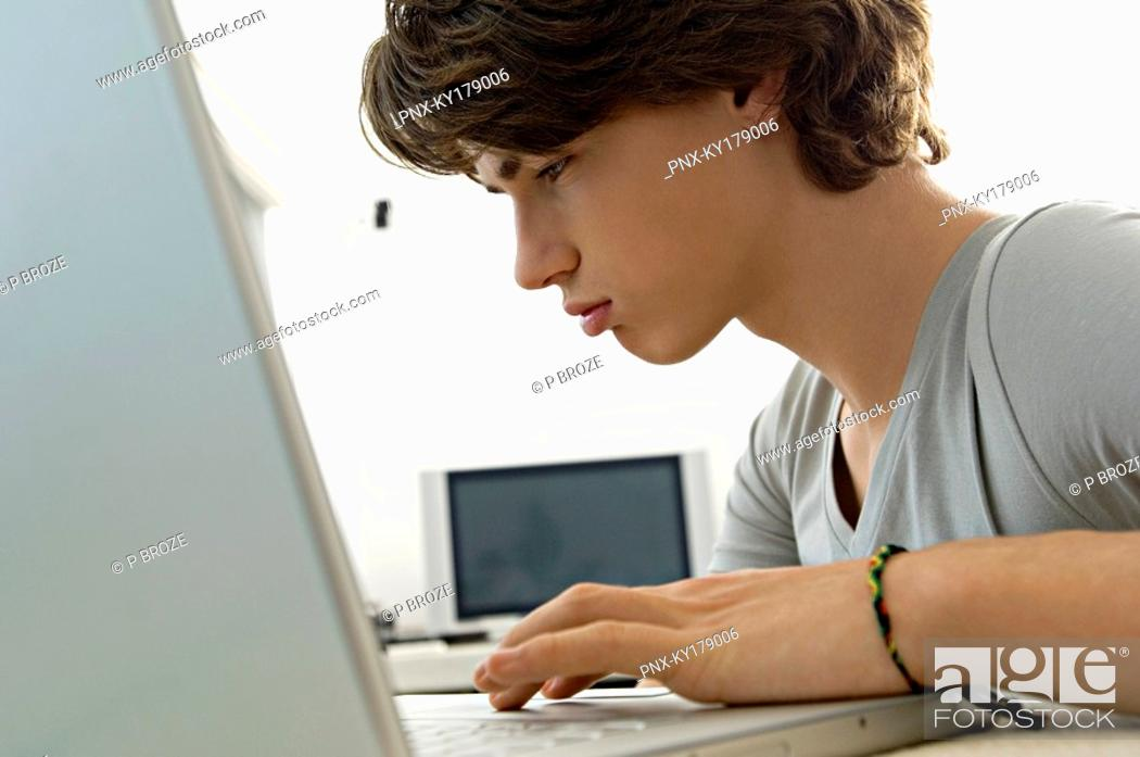Stock Photo: Close-up of a teenage boy using a laptop.