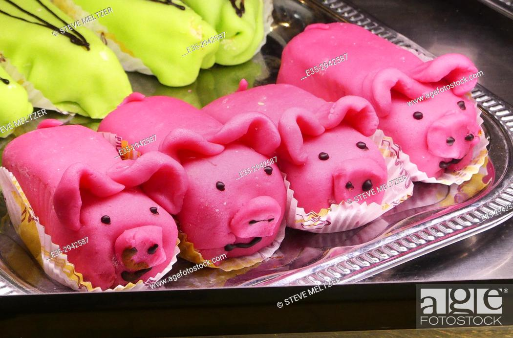 Stock Photo: Marizpan pastry pigs in a shop window in Narbonne, France.