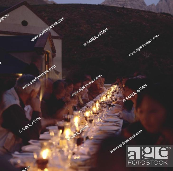 Stock Photo: People at table with wine, Neil Ellis Wines, Stellenbosch.