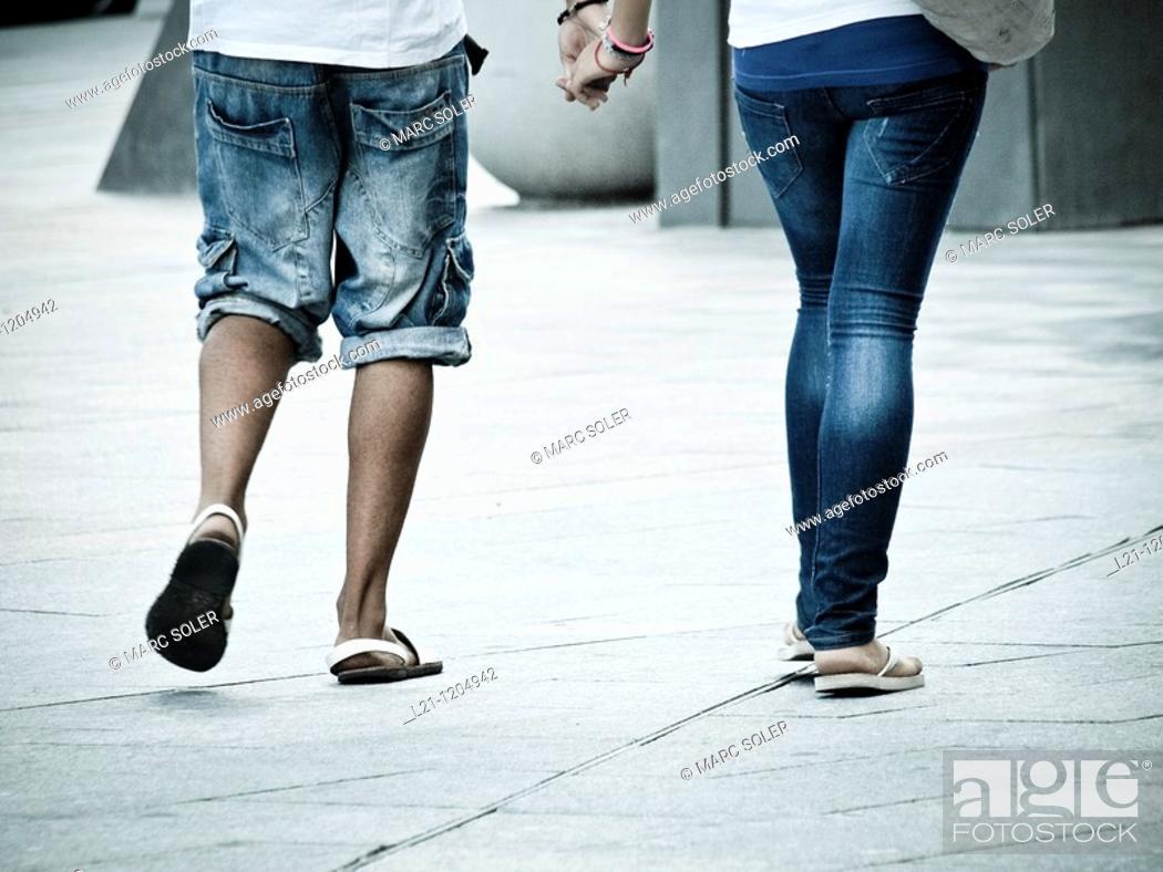 Stock Photo: Couple walking down the street.