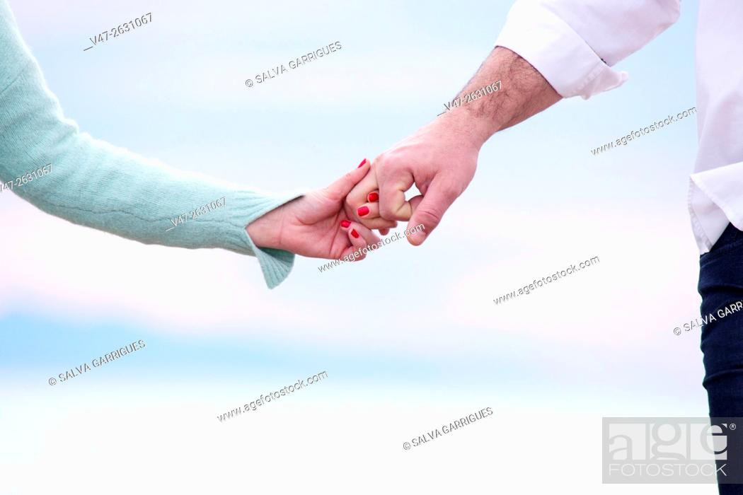 Stock Photo: Wedding couple holding hands on the beach of Saler, Valencia, Spain, Europe.