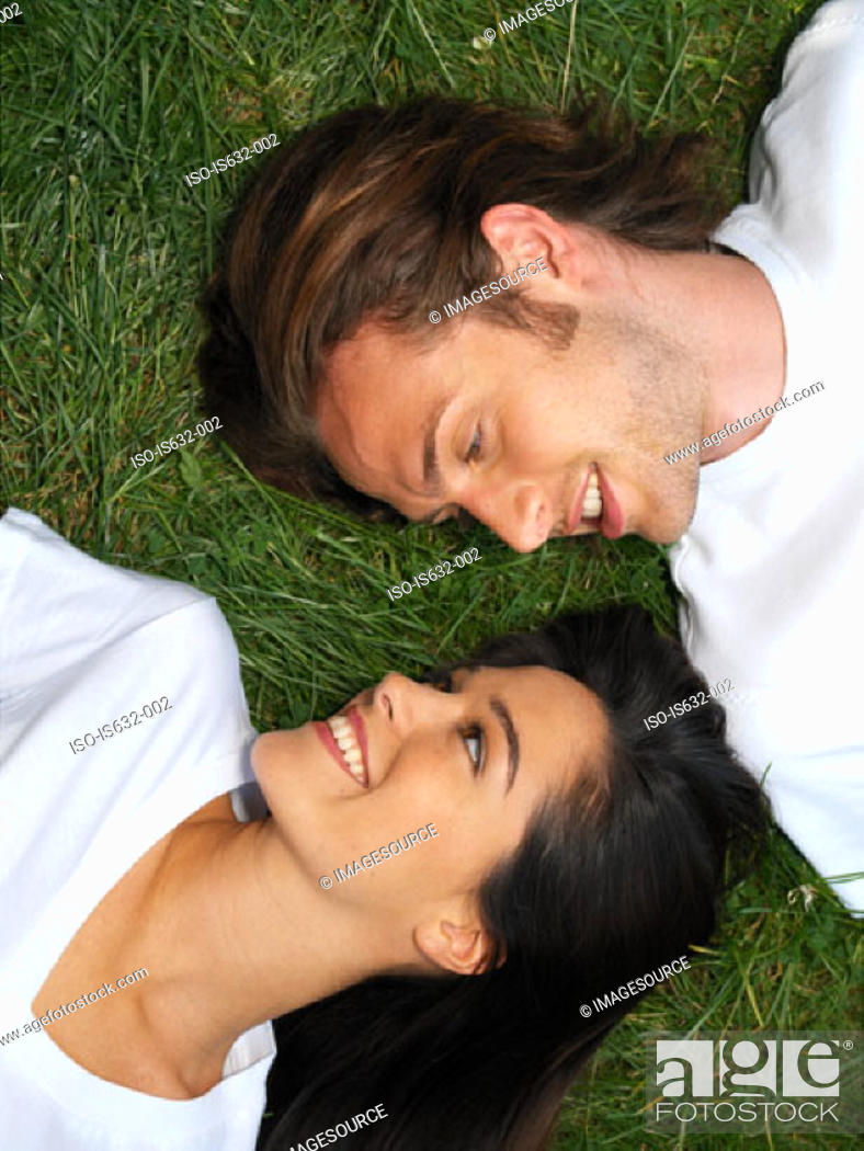 Stock Photo: Young couple relaxing on grass.