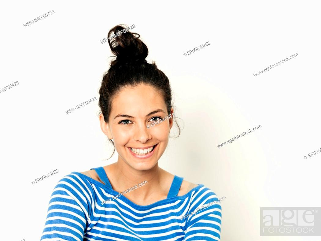 Stock Photo: Beautiful young woman with black hair and blue white striped sweater is posing in front of white background.