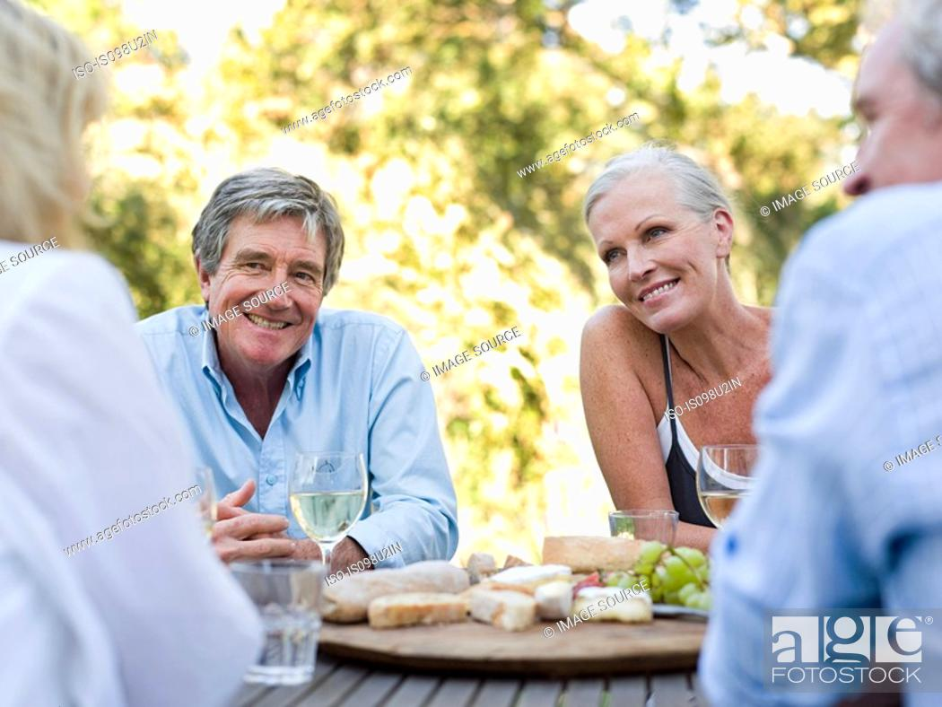 Stock Photo: Friends at meal outdoors.