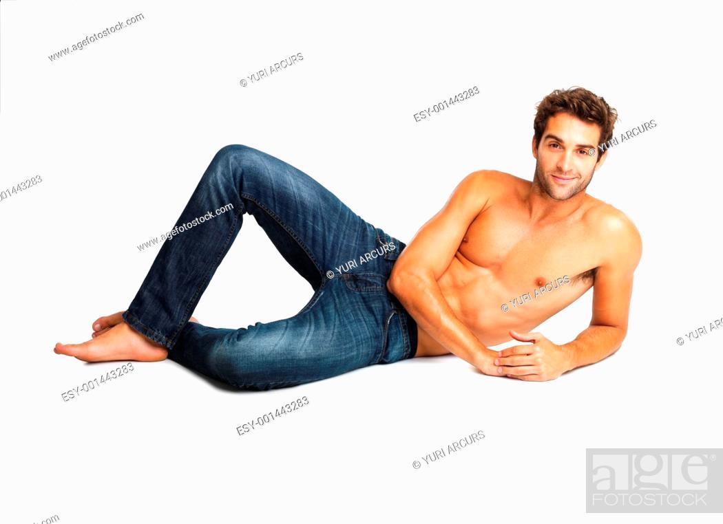 Stock Photo: Flirtatious shirtless man lying down.