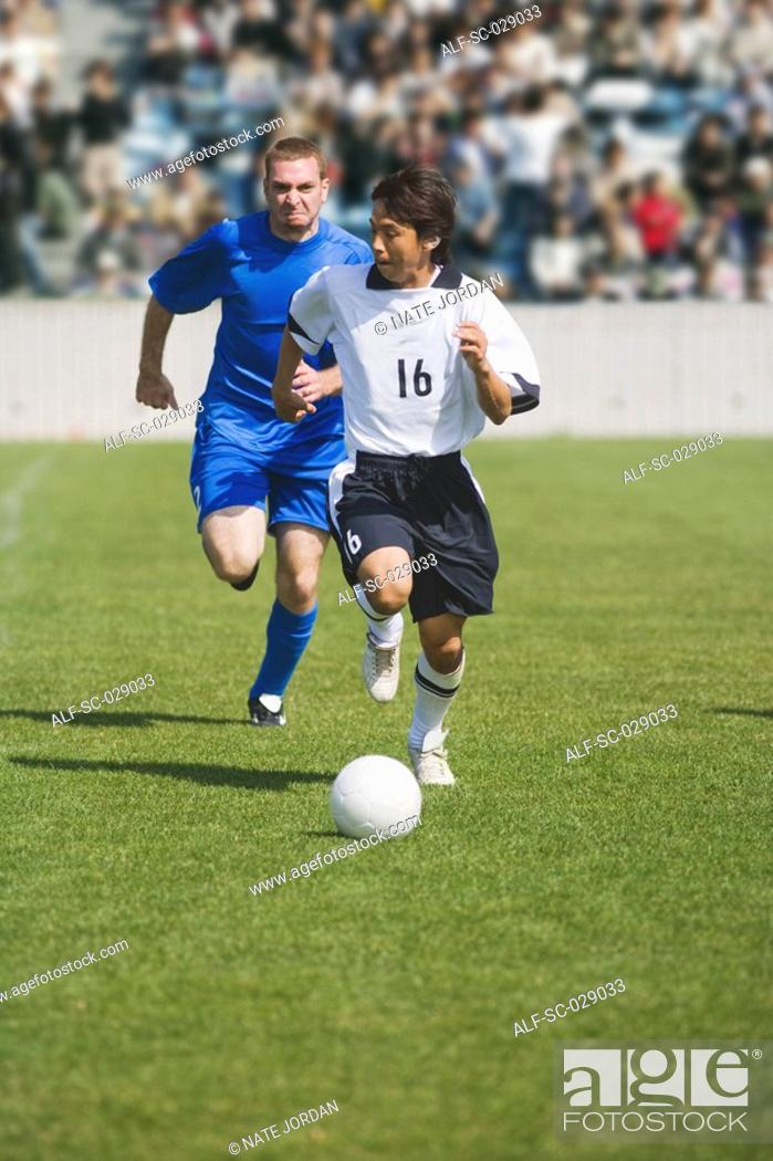 Stock Photo: Defender Chasing the Opposition.