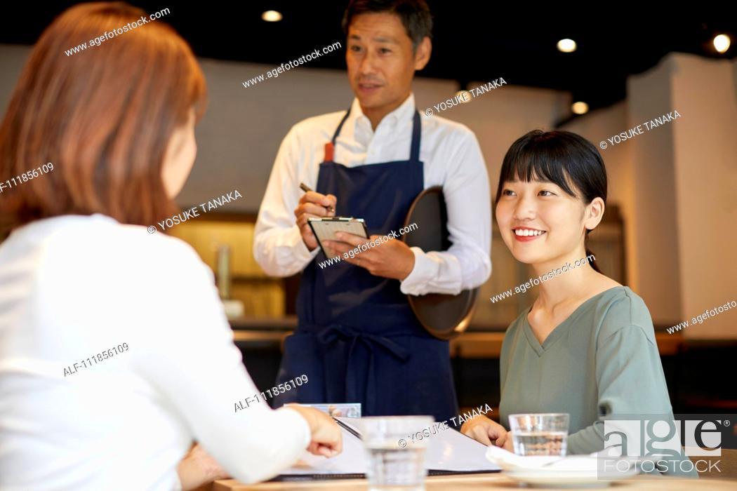Stock Photo: Japanese women at a restaurant.