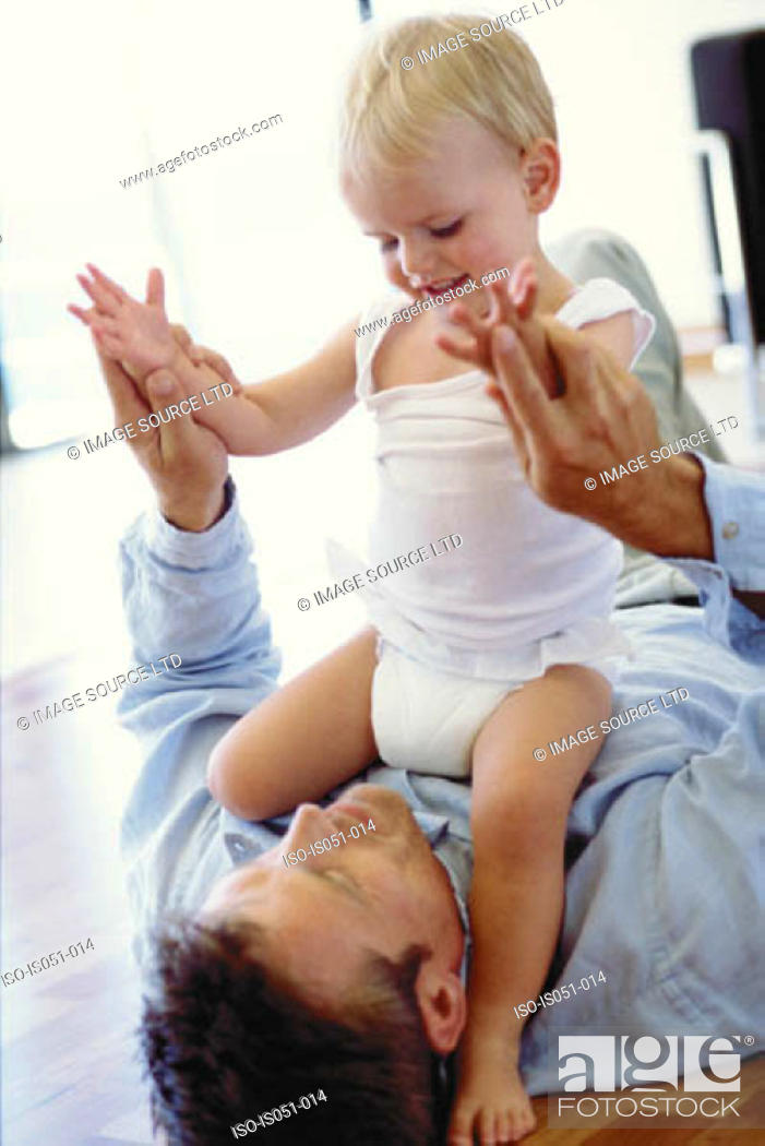Stock Photo: Father playing with toddler.
