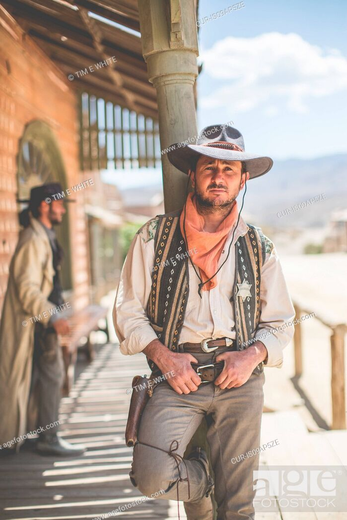 Imagen: Portrait of cowboy leaning against pillar on wild west film set, Fort Bravo, Tabernas, Almeria, Spain.