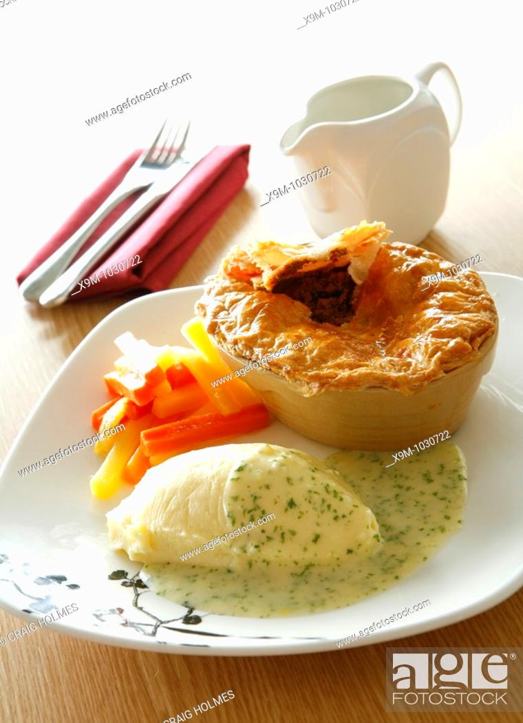 Stock Photo: Pie, mash and vegtables with a parsley sauce.