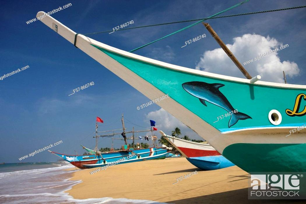 Stock Photo: Outrigger fishing boats on Hikkaduwa beach, Sri Lanka.