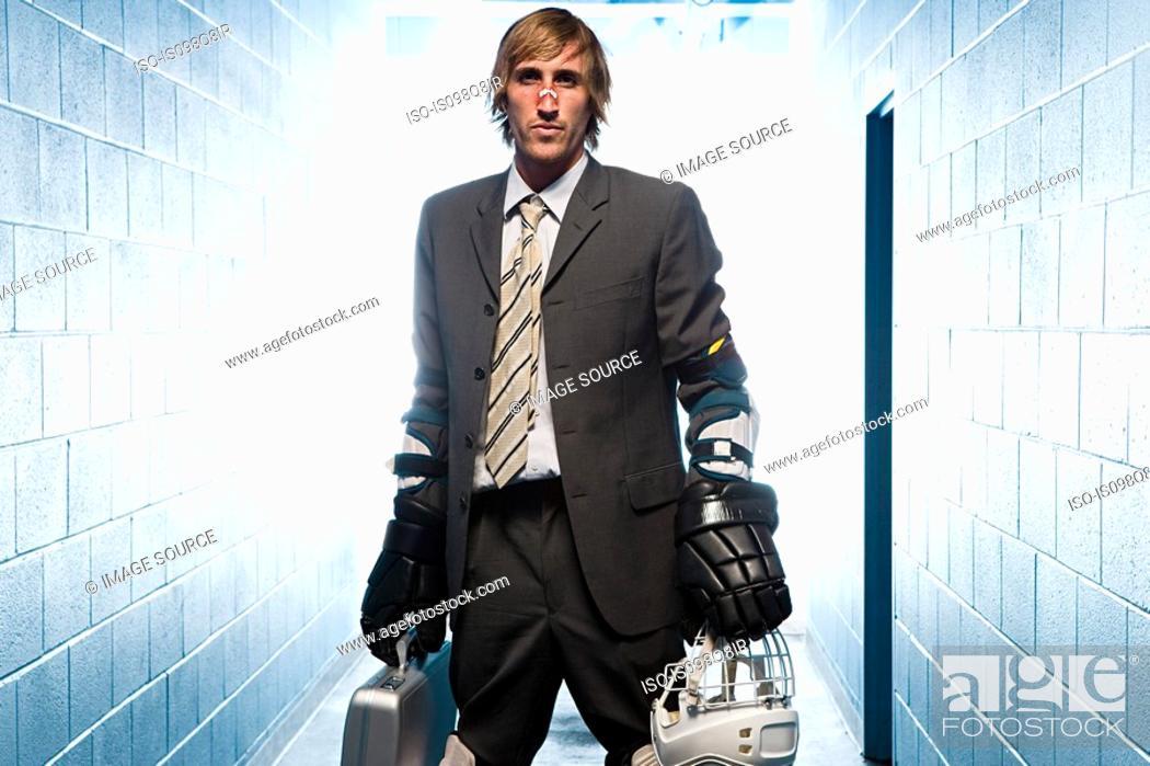 Stock Photo: Businessman with an ice hockey uniform.
