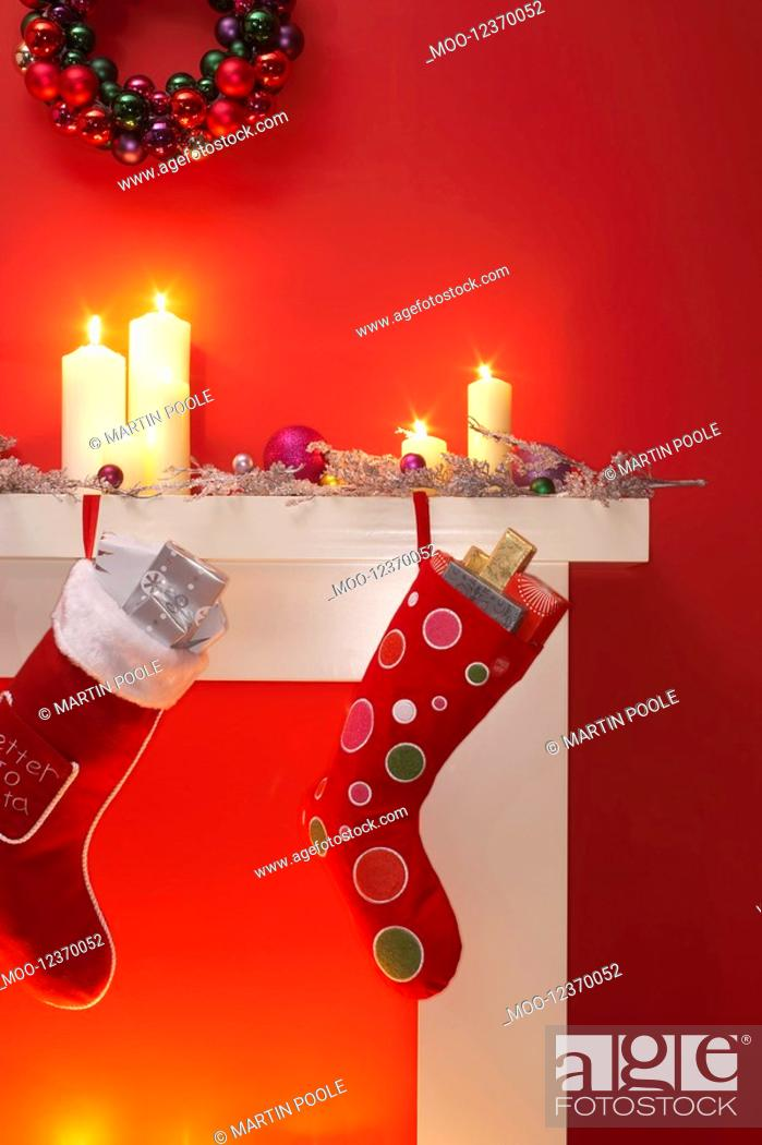Stock Photo: Christmas stockings hanging over fireplace.