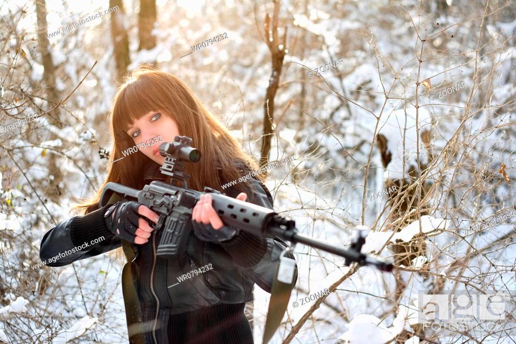 Stock Photo: Brunette girl aiming a gun.