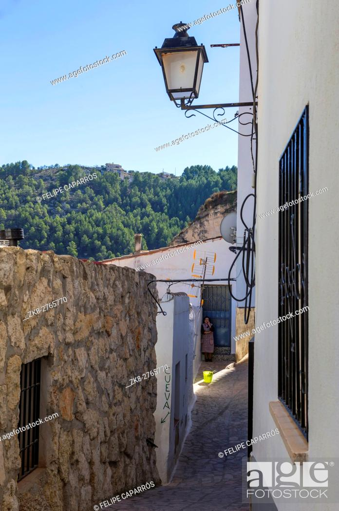 Stock Photo: Narrow street with white painted houses, typical of this town, take in Alcala of the Jucar, Albacete province, Spain.