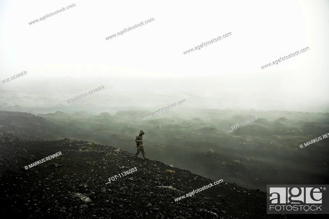 Stock Photo: A hiker walking through the fog, Plosky Tolbachik Volcano, Russia.