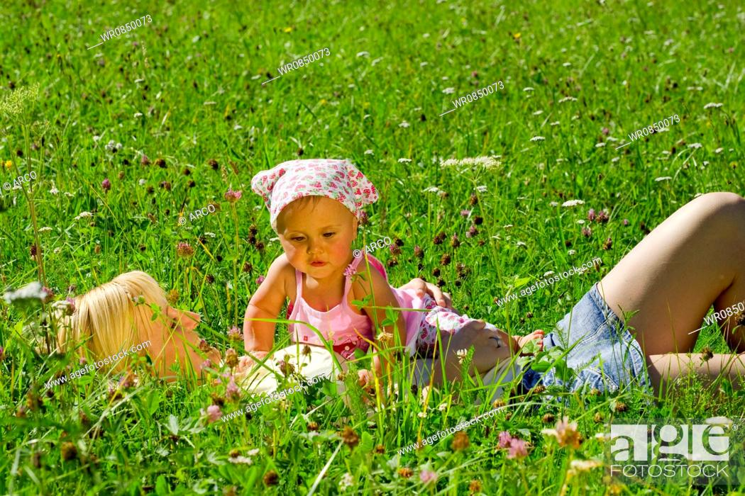 Stock Photo: Mother and daughter in meadow.