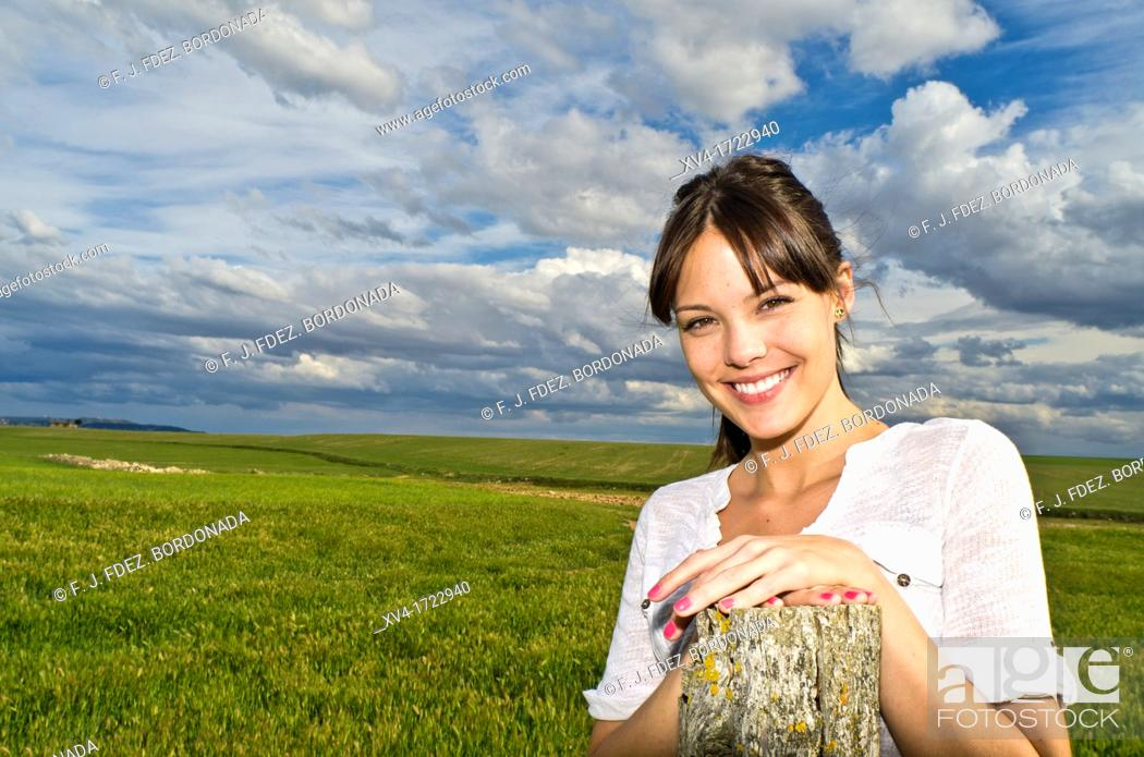 Stock Photo: Pretty girl relaxing in the ruralscape and look at camera, Aragon, Spain.