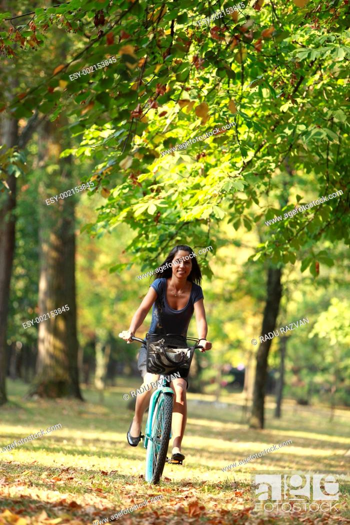 Stock Photo: Woman riding a bicycle.