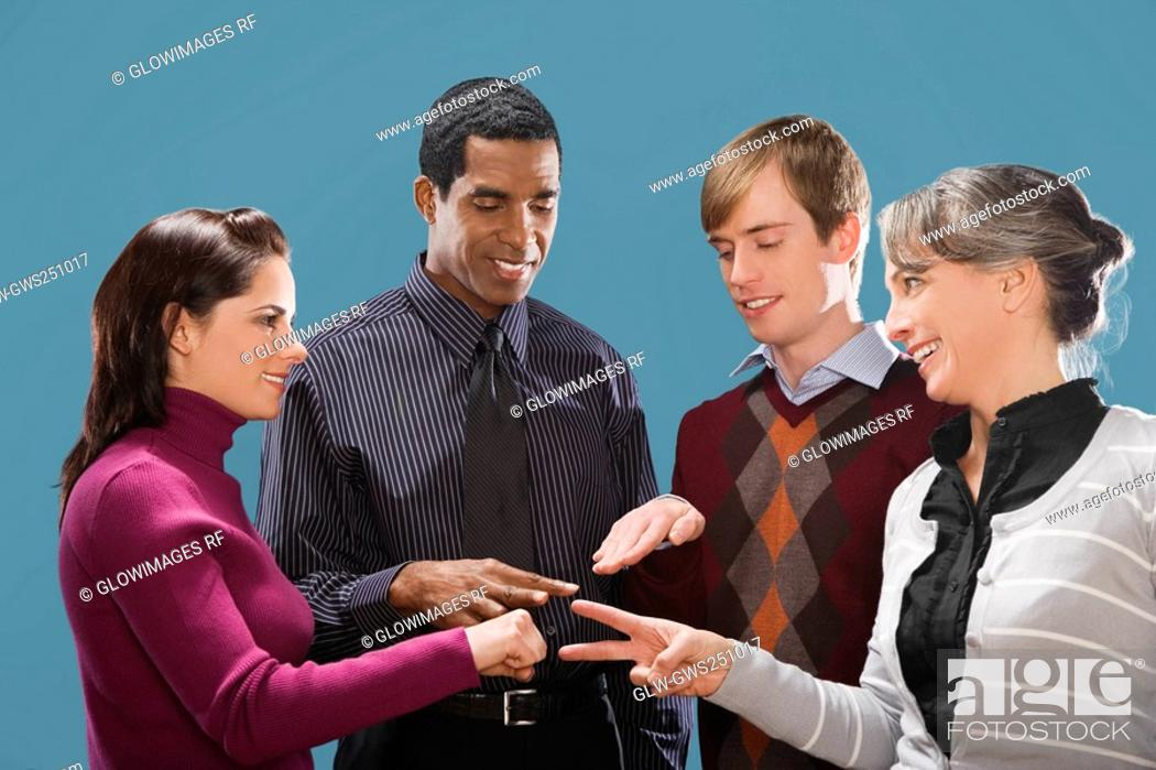 Stock Photo: Four business executives making hand signs.