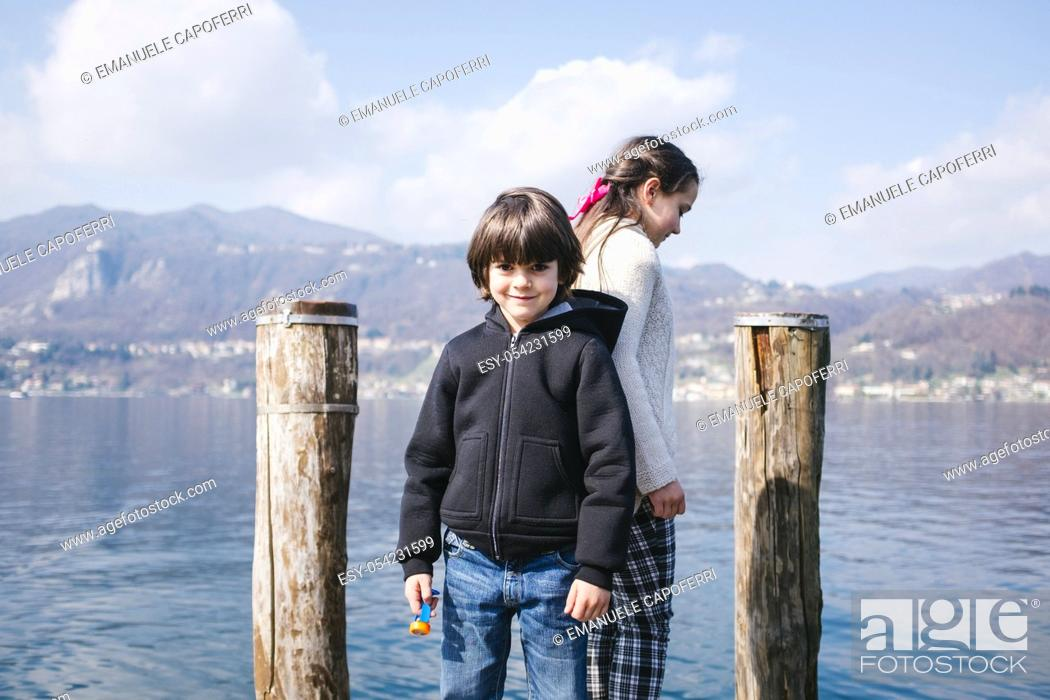 Stock Photo: Children on the dock at Orta, Lake Orta, Piedmont, Italy.