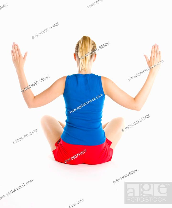 Stock Photo: exercising woman.