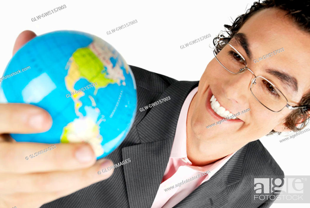 Stock Photo: Close-up of a businessman holding a globe and smiling.
