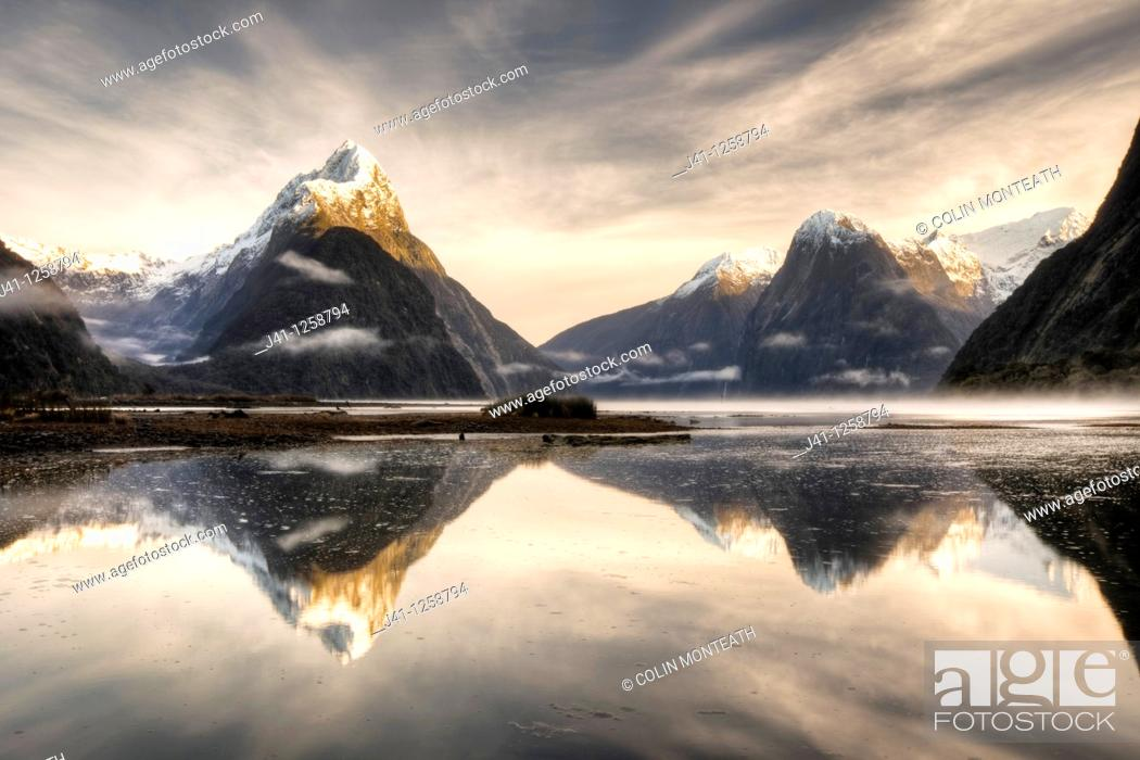 Stock Photo: Mitre peak, winter dawn, cold mist rising from Milford Sound, Fiordland National Park.