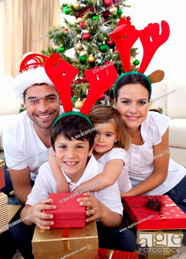 Photo de stock: Lovely family giving presents for Christmas.