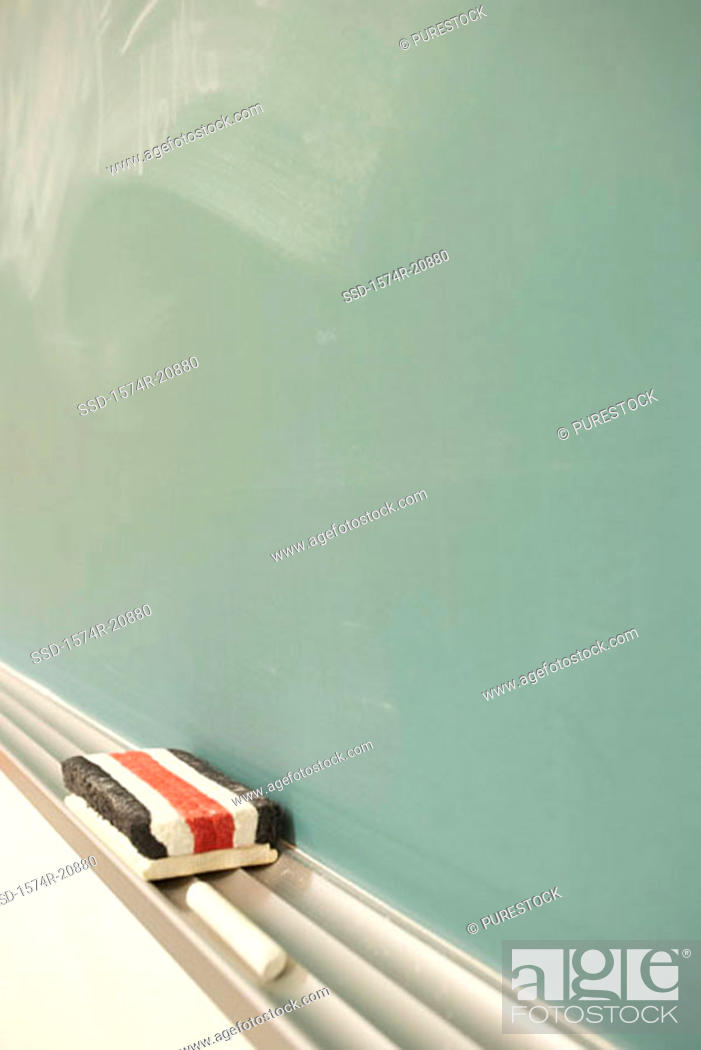 Stock Photo: Close-up of a chalk and an eraser.
